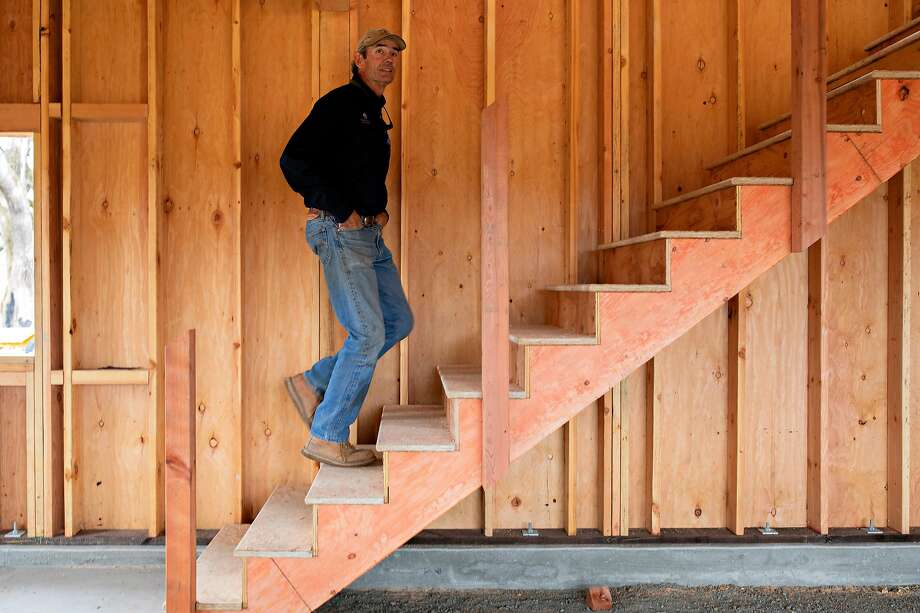 Scott Newman checks inside a new building on his Knights Valley ranch that replaces one he lost to the 2019 Kincade Fire. Photo: Santiago Mejia / The Chronicle