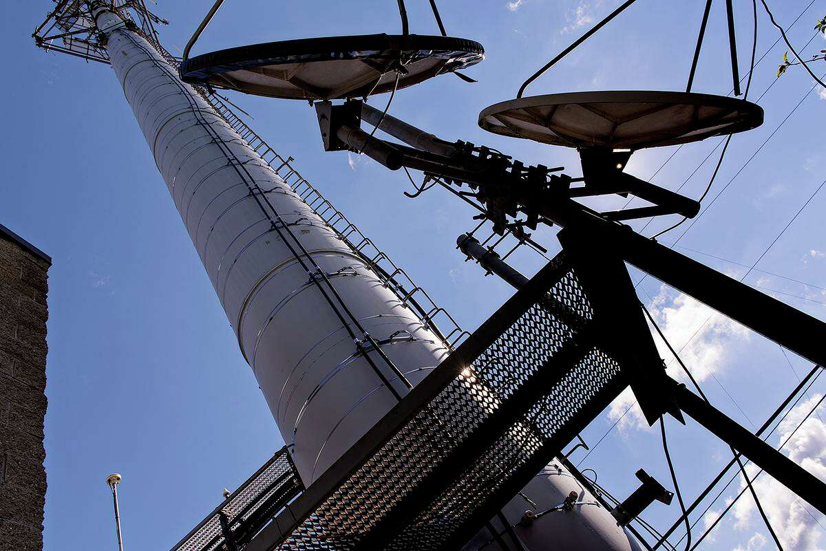 Crown Castle International operates a large network of cell phone towers and other wireless infrastructure. Microwave dishes on a monopole near Pittsburgh are shown.