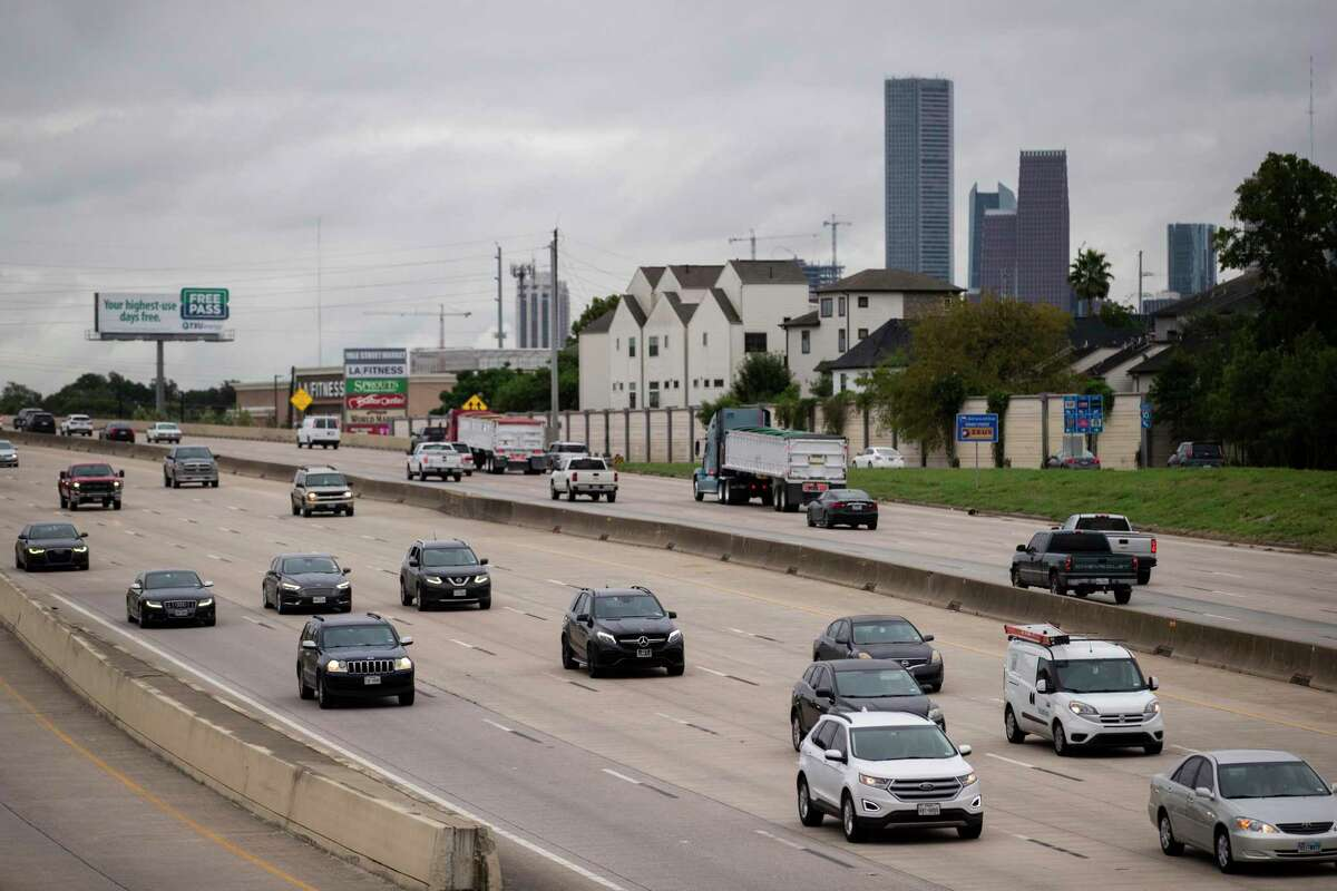 Traffic moves along Interstate 10 near Patterson Street with the Houston skyline on the background on Sept. 24, 2020, in Houston. Officials plan to build managed lanes along the freeway, to accommodate faster transit and carpool trips.