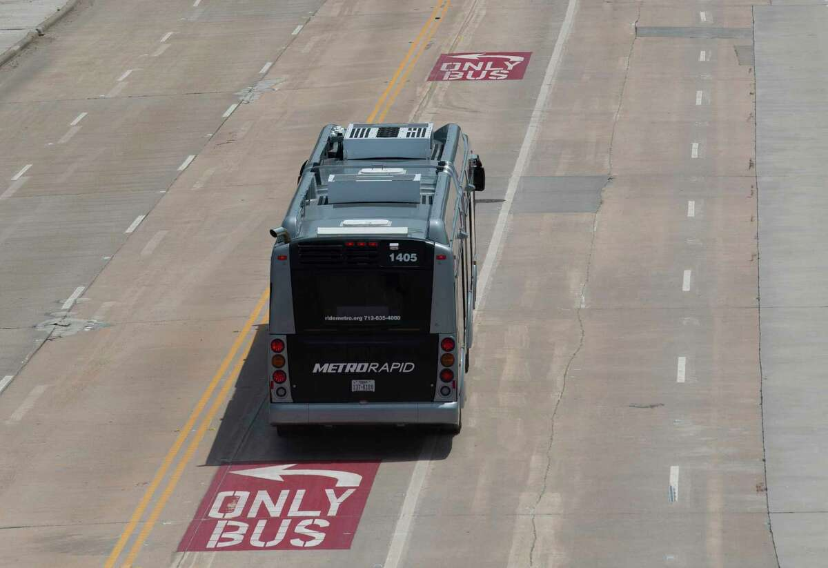 A Silver Line bus rapid transit bus drives on the designated bus lane on Westpark Drive as the line starts service on Aug. 23, 2020, in Houston. Bus rapid transit like the new Silver Line would be added between the transit center and downtown, along transit lanes along Interstate 10.