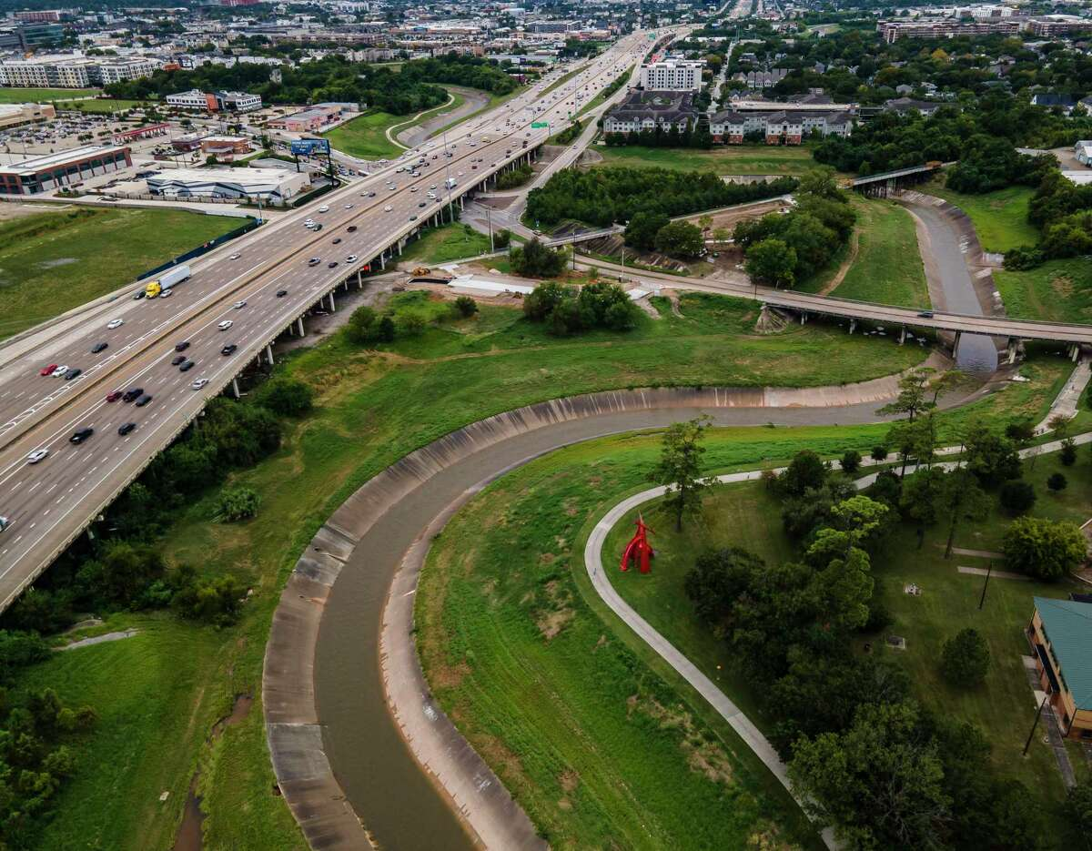 Interstate 10 runs along White Oak Bayou near Stude Park, seen on Sept. 24, 2020, in Houston. Officials plan to build managed lanes along the freeway, to accommodate faster transit and carpool trips.