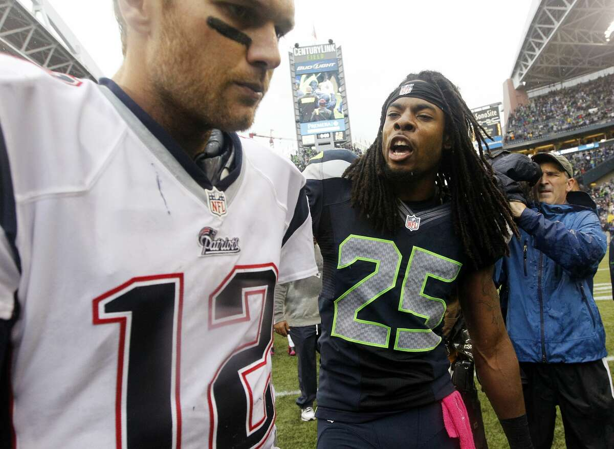 Seattle Seahawks' Richard Sherman talks with New England Patriots quarterback Tom Brady on Oct. 14, 2012, after the Seahawks won 24-23 in an NFL football game in Seattle.