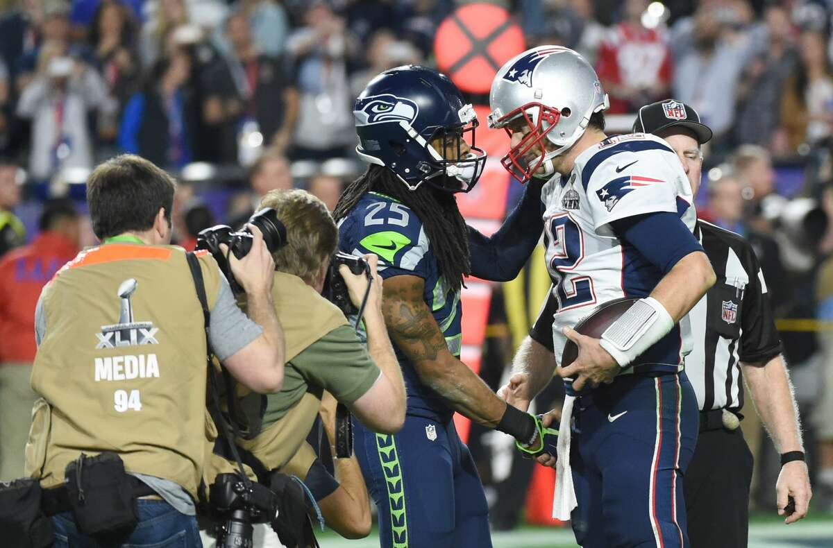 New England Patriots quarterback Tom Brady, right, is congratulated by Richard Sherman of the Seattle Seahawks during Super Bowl XLIX on Feb. 1, 2015, in Glendale, Ariz. The Patriots defeated the Seahawks 28-24.