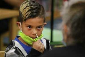 Technicians from Community Labs tested staff and students at Barrera Veterans Elementary School in the Somerset Independent School District in South Bexar County for the coronavirus last month. Harvey Hernandez, a first grader, swabs the inside of his nose during the test.
