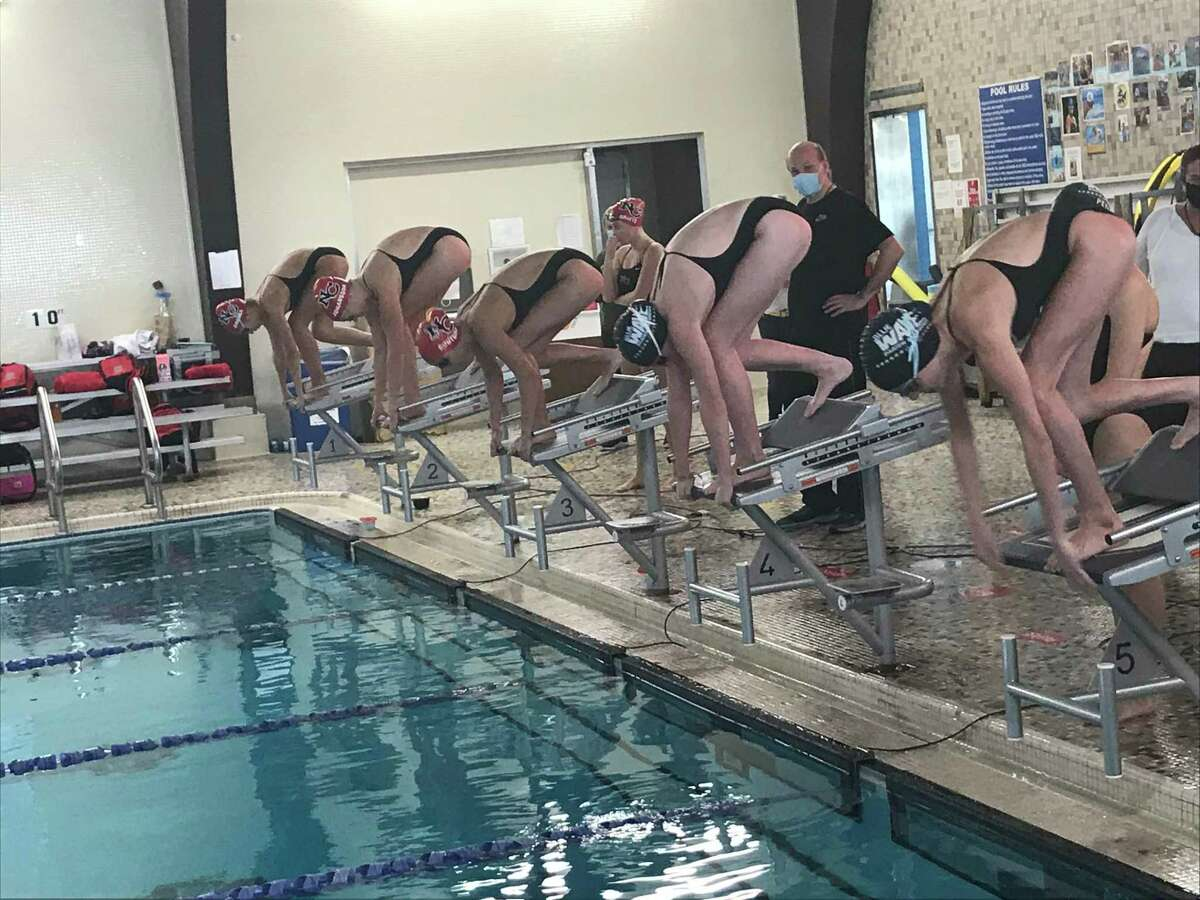 The Darien and New Canaan girls swimming teams renewed their rivalry on Wednesday, October 22, 2020.