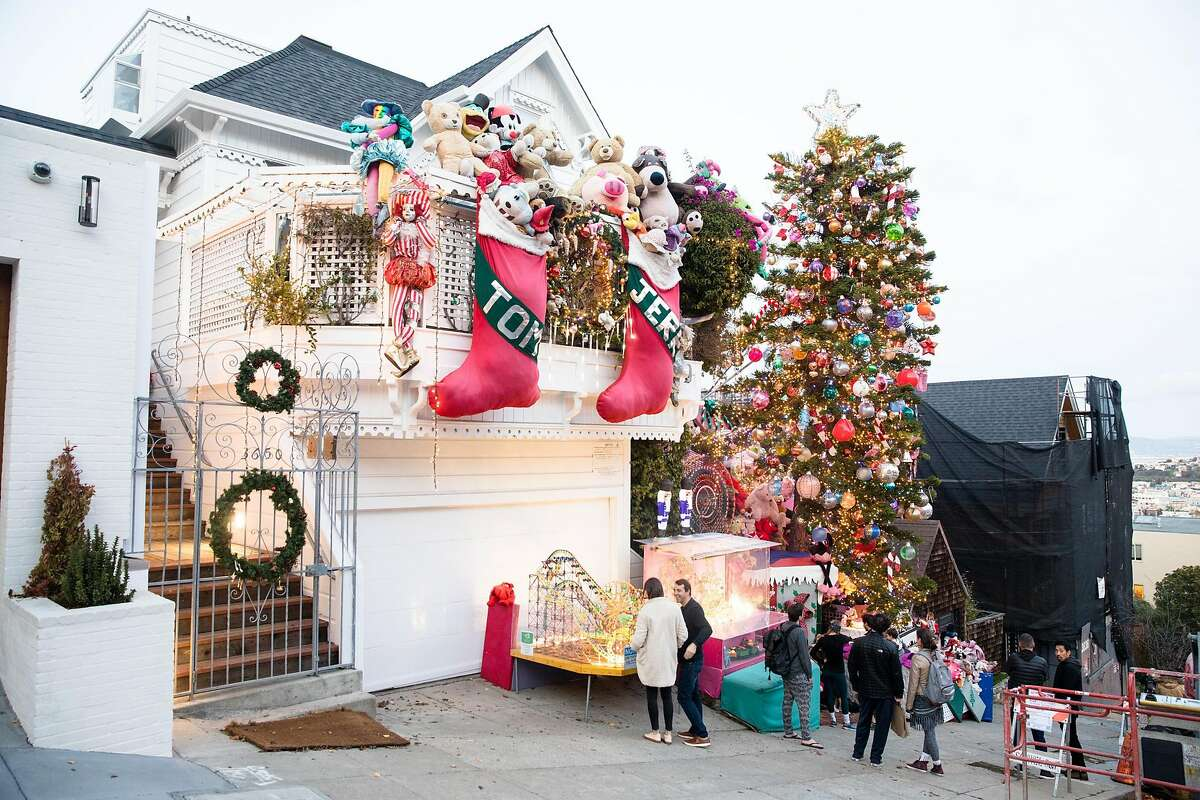 People visit the Tom and Jerry House in San Francisco on Dec. 15, 2019. For years, Tom Taylor and his husband Jerome