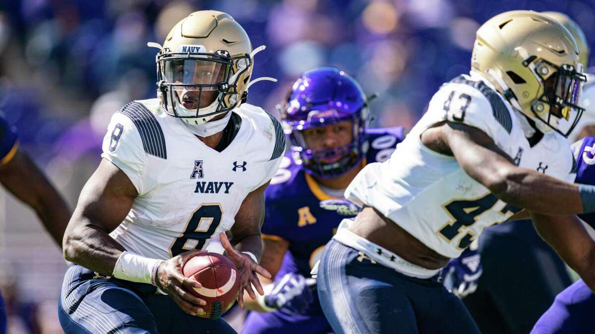 Dalen Morris (8), expected to play against UH on Saturday after a hard hit forced his early exit against East Carolina last week, has established himself as Navy's starting quarterback this season.