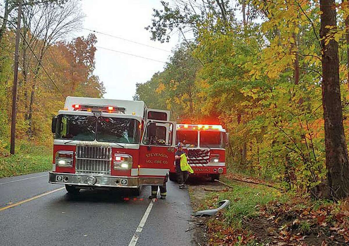 Crews on scene for a rollover crash on Route 34 in Monroe, Conn., on Wednesday, Oct. 21, 2020.
