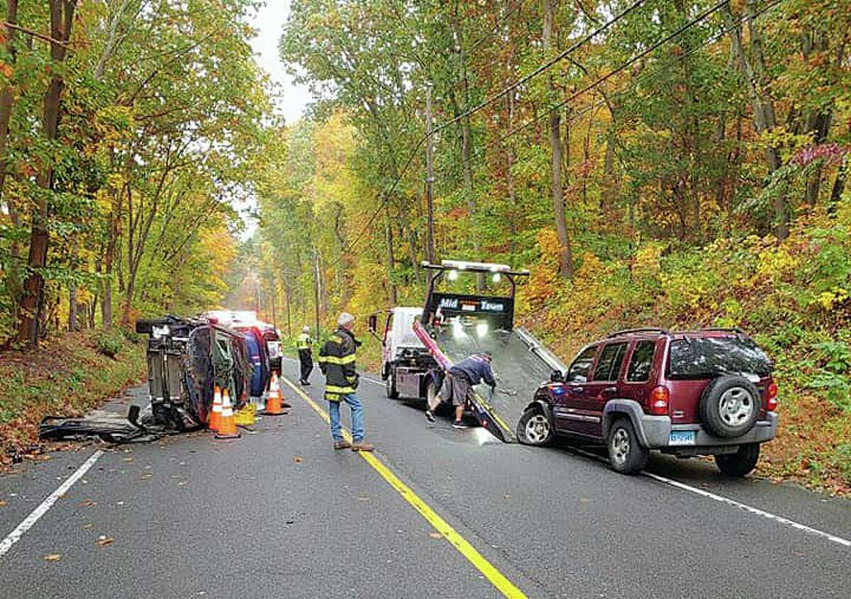A rollover crash on Route 34 in Monroe, Conn., on Wednesday, Oct. 21, 2020.
