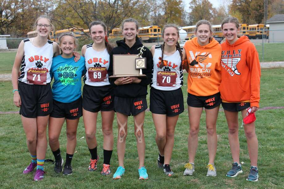 The Ubly girls team consisting of Abbie Guza, Emily Greyerbiehl, Josie Gusa, Erica Klee, Maze Gusa, Alexiss Guigar, Aran Harris also claimed the girls league title on Tuesday. The Bearcats edged Sandusky by two points to claim the crown. Photo: Courtesy Photo