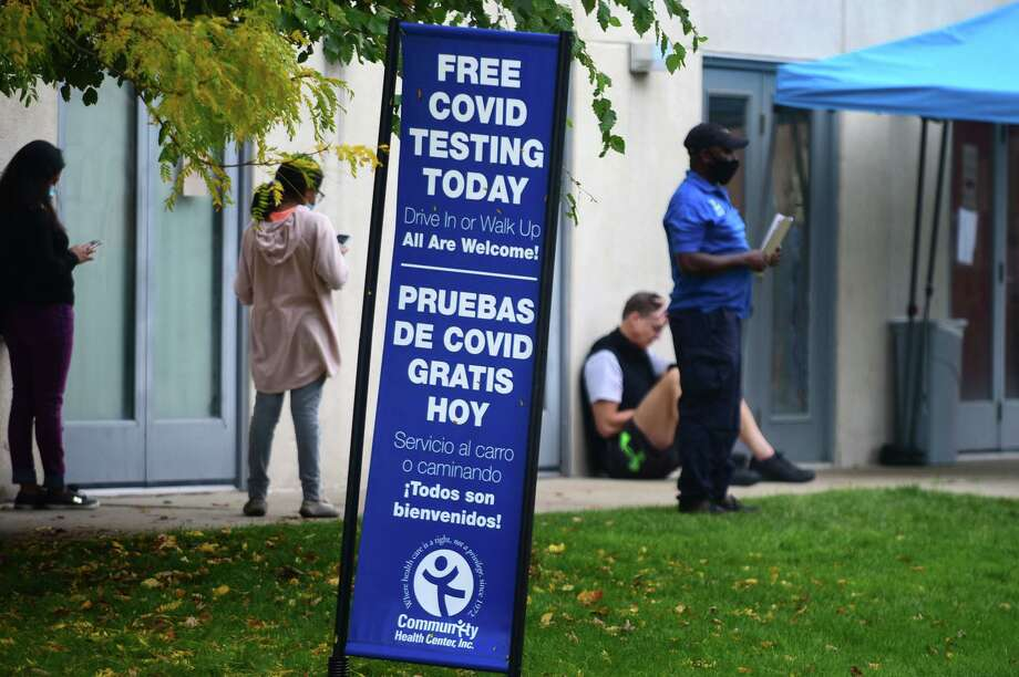 Local residents cue up for COVID-19 testing at the Community Health Center on Day Street, Wednesday, October 21, 2020, in Norwalk, Conn Photo: Erik Trautmann / Hearst Connecticut Media / Norwalk Hour