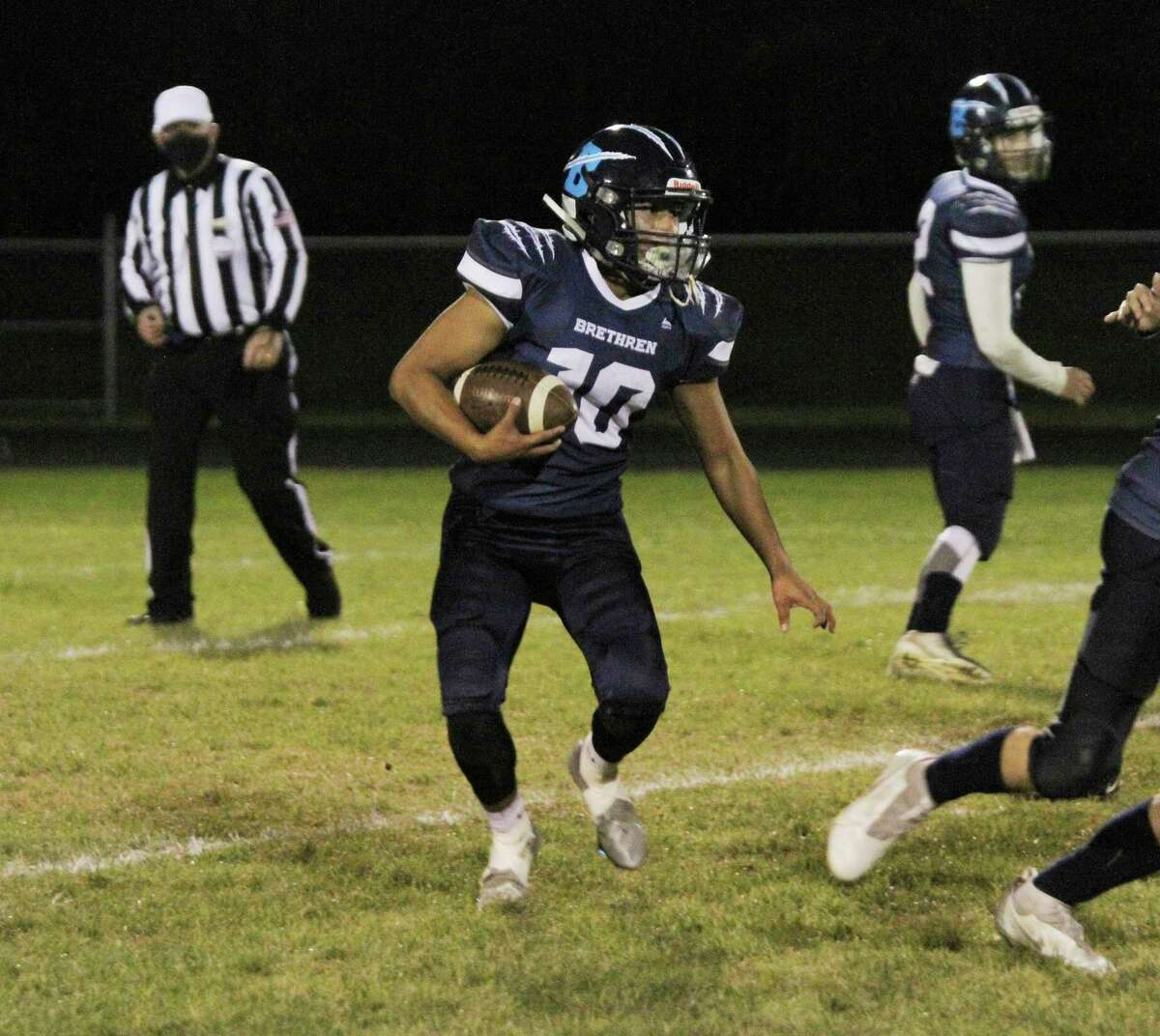 Brethren's Kenny King looks for room to run Friday night during the Bobcats' victory over Manistee Catholic Central. (News Advocate file photo)
