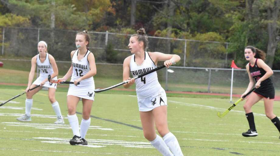 Sophomore Maura Carbone (4) scored the game-winning goal in the Eagles' victory over Fairfield Warde. Trumbull's Alexandra Baratta (12) and Ella Consia (16) hone in on the action. Photo: Trumbull Athletics / Contributed Photo / Trumbull Times