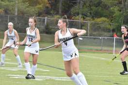 Sophomore Maura Carbone (4) scored the game-winning goal in the Eagles' victory over Fairfield Warde. Trumbull's Alexandra Baratta (12) and Ella Consia (16) hone in on the action.