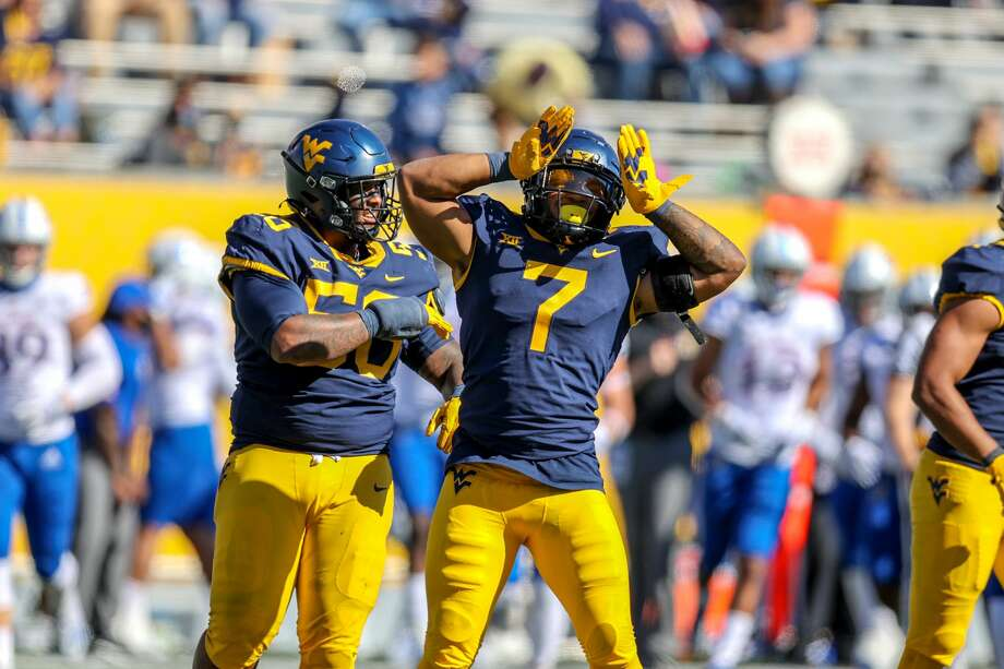 MORGANTOWN, WV - OCTOBER 17: West Virginia Mountaineers defensive lineman Darius Stills (56) and West Virginia Mountaineers linebacker Josh Chandler-Semedo (7) celebrate after a defensive stop during the third quarter of the college football game between the Kansas Jayhawks and the West Virginia Mountaineers on October 17, 2020, at Mountaineer Field at Milan Puskar Stadium in Morgantown, WV. (Photo by Frank Jansky/Icon Sportswire via Getty Images) Photo: Icon Sportswire/Icon Sportswire Via Getty Images / ©Icon Sportswire (A Division of XML Team Solutions) All Rights Reserved