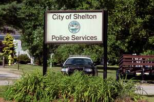 A view of the Shelton Police Department sign in Shelton, Conn., on Tuesday June 21, 2020.