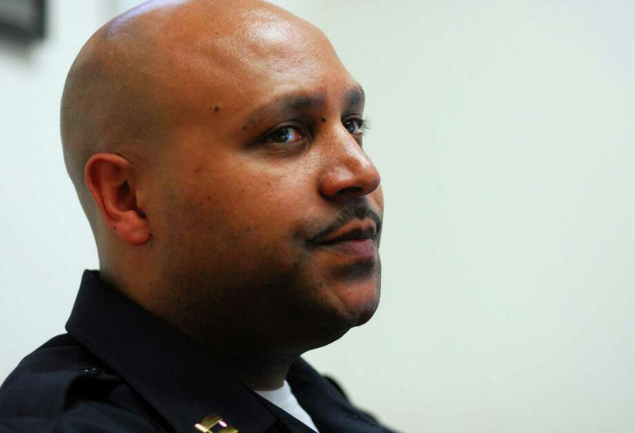 Shelton Police Department's Captain Shawn Sequeira at police headquarters in Shelton, Conn., on Wednesday Apr. 29, 2015. Sequeira is a retired Connecticut State Police officer and has come out of retirement to become the first black supervisor in Shelton police department history. Photo: Christian Abraham / Christian Abraham / Connecticut Post