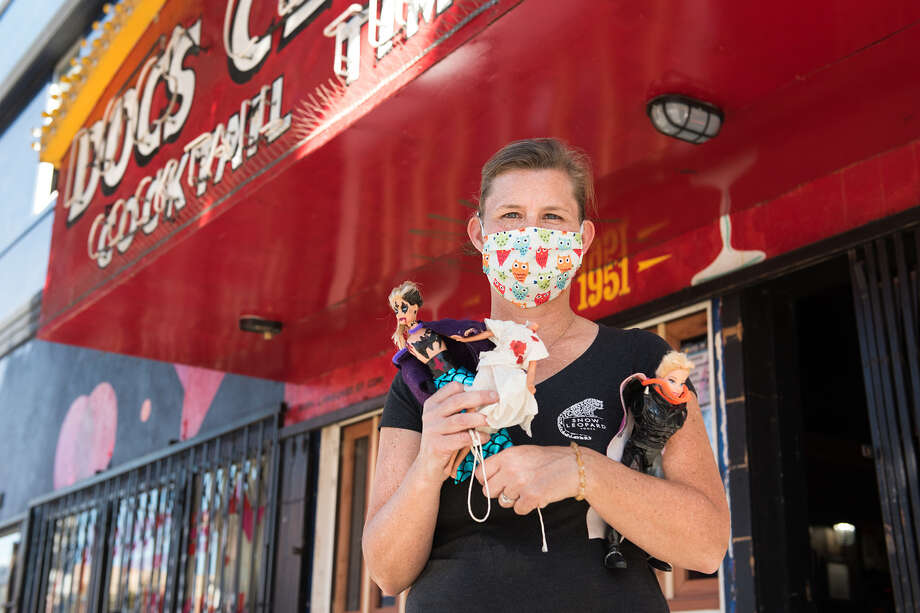 Unrealistic Beauty Standards and Restrictive Gender Norms Mutilation Night is an annual tradition at Doc's Clock bar in the Mission. Owner Carey Suckow holds some of her favorite Barbies from years past. Photo: Blair Heagerty/SFGATE