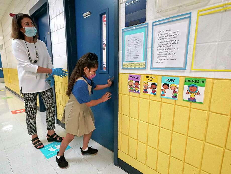 A student enters a classroom at Eliot Elementary School, 6411 Laredo St., on Monday, Oct. 19, 2020 in Houston. Monday is the first day of in-person classes in Houston ISD. Photo: Melissa Phillip, Houston Chronicle / Staff Photographer / © 2020 Houston Chronicle