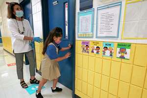 A student enters a classroom at Eliot Elementary School, 6411 Laredo St., on Monday, Oct. 19, 2020 in Houston. Monday is the first day of in-person classes in Houston ISD.