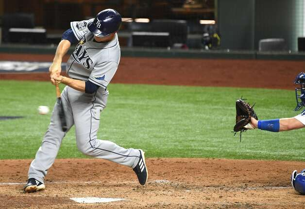 The Tampa Bay Rays' Joey Wendle hits a two-run double against the Los Angeles Dodgers in the fourth inning in Game 2 of the World Series at Globe Life Field in Arlington, Texas, on Wednesday, Oct. 21, 2020. (Wally Skalij/Los Angeles Times/TNS) Photo: Wally Skalij / TNS