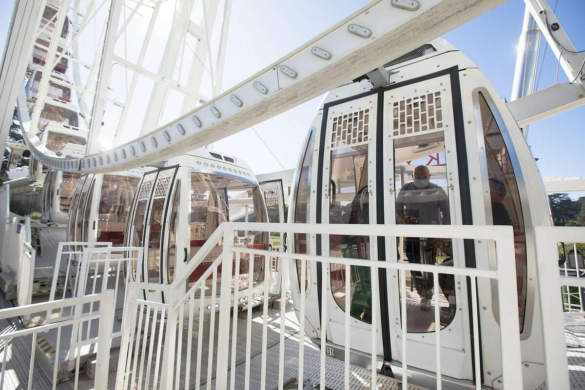 Passengers board a SkyStar Observation Wheel gondola on opening day at the Golden Gate Park Music Concourse in San Francisco, California on October 21, 2020.