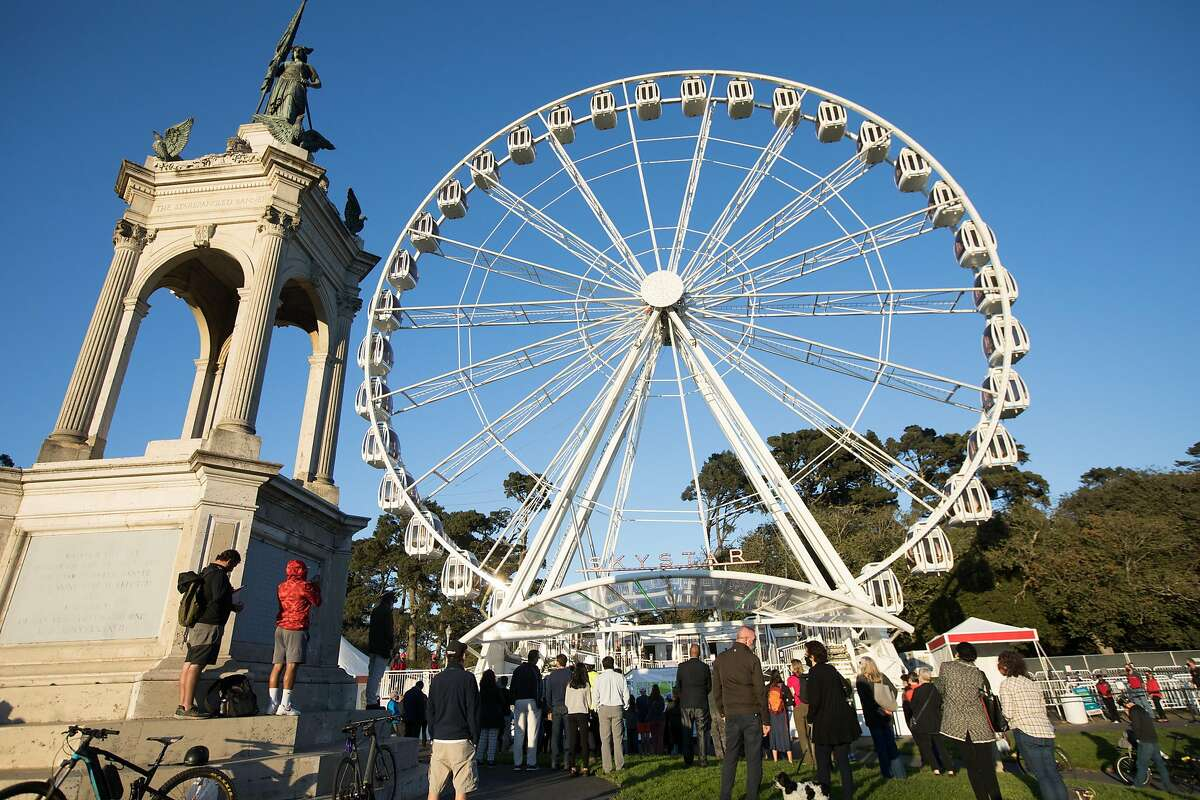 People gather for the ribbon cutting of the SkyStar Observation Wheel at the Golden Gate Park Music Concourse in San Francisco, California on October 20, 2020.