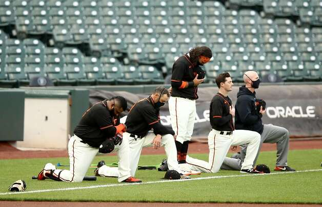 Brandon Crawford #35 stands in the middle of Pablo Sandoval #48, manager Gabe Kapler, Mike Yastrzemski #5 and coach Andy King (L-R) of the San Francisco Giants during the National Anthem before their exhibition game against the Oakland Athletics at Oracle Park on July 21, 2020 in San Francisco, California. (Photo by Ezra Shaw/Getty Images/TNS) Photo: Ezra Shaw / TNS