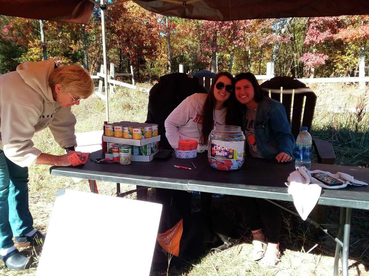 The Lake County ORV community collected raffle donations as well as food donations during the food drive on Oct. 10. Assisting with the collections are Kayla O'Dea and a friend. The O'Dea family organized the event. (Submitted photo)