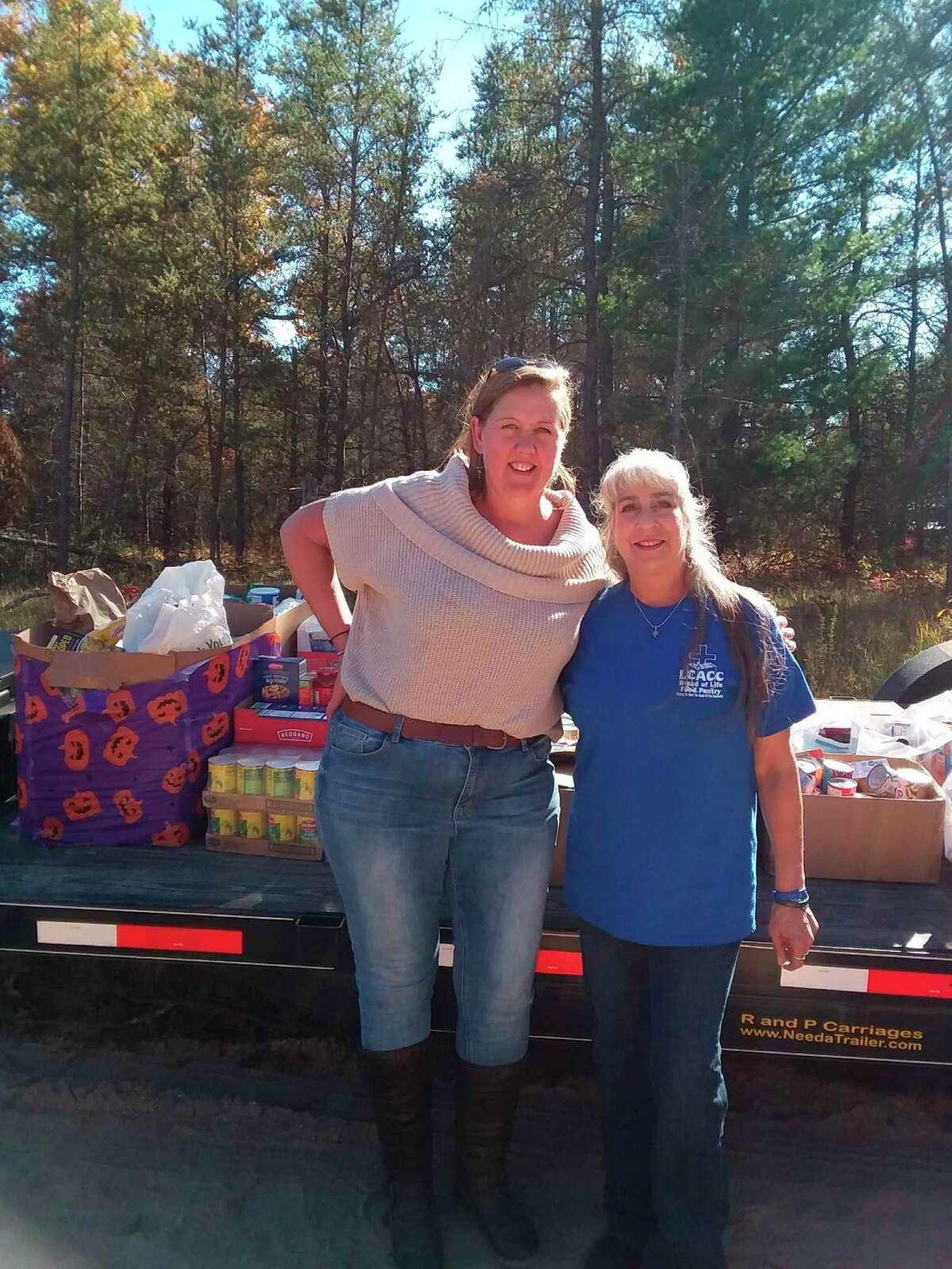 Kimberley O'Dea, left, helped to organized the Lake County ORV community food drive to benefit Bread of Life Pantry on Oct. 10. O'Dea and pantry director Lynne Mills stand next to the donated food. (Submitted photo)