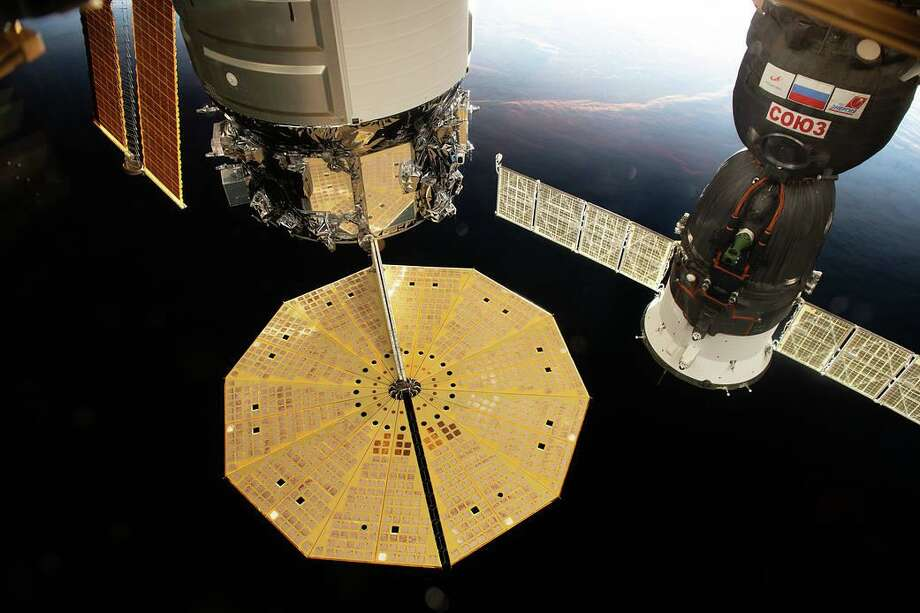 Two spacecraft are pictured docked to the International Space Station as the complex flew into an orbital sunset above the Tasman Sea in between Australia and New Zealand on Oct. 18, 2020. Photo: NASA