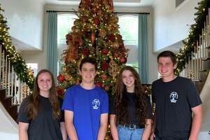 Taylor High School's Holiday Home Tour is slated for Thursday, Dec. 3, through Saturday, Dec. 5. The tour features homes decorated for the holidays and raises funds for the school's Project Graduation, which gives seniors a safe way to celebrate their graduation. Here from left, Maya Geraci, Matthew Stokes, Megan McNichol and Ethan Mefford, all Taylor seniors and children of Project Graduation board members, pose at a tour home on Wednesday, Oct. 21.