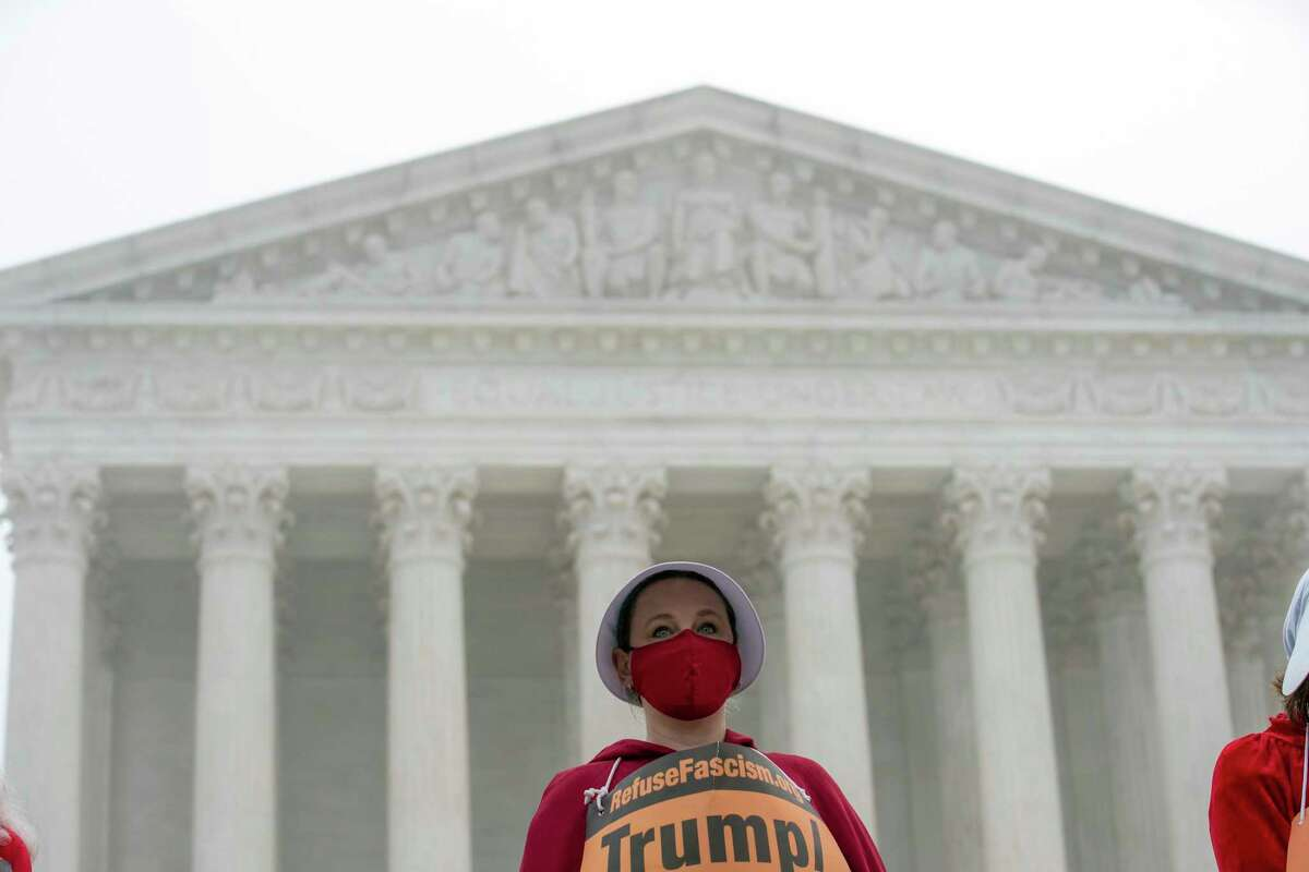 Activists opposed to the confirmation of President Donald Trump's Supreme Court nominee, Judge Amy Coney Barrett, dressed as characters from