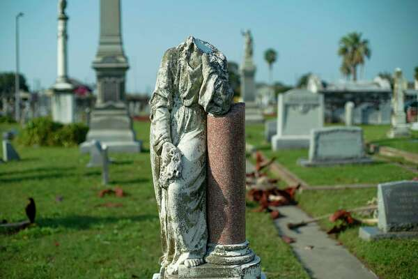 A broken headstone at Evergreen Cemetery in Galveston, Texas on Tuesday, Oct. 13, 2020.