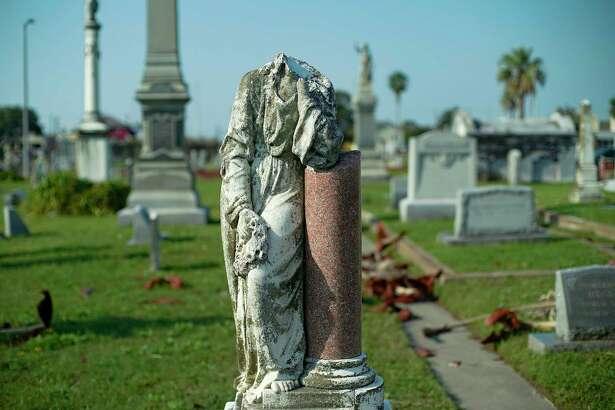 A broken headstone at Evergreen Cemetery in Galveston, Texas on Tuesday, Oct. 13, 2020.