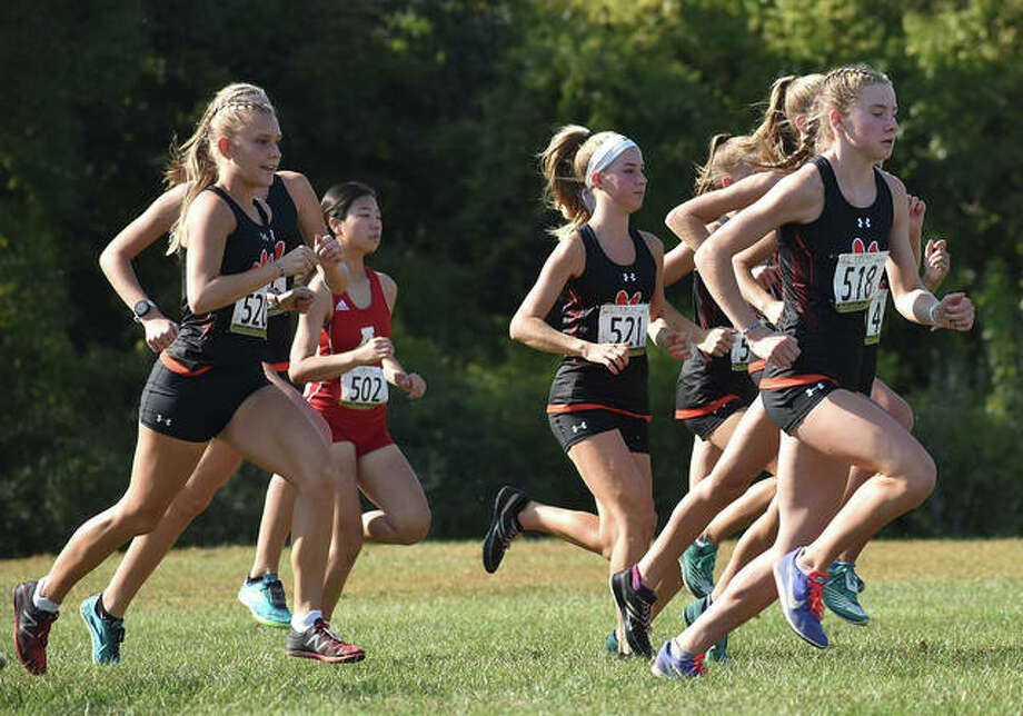 Members of the Edwardsville girls cross country team get off to a fast start at the Madison County Meet inside Gordon Moore Park in Alton.