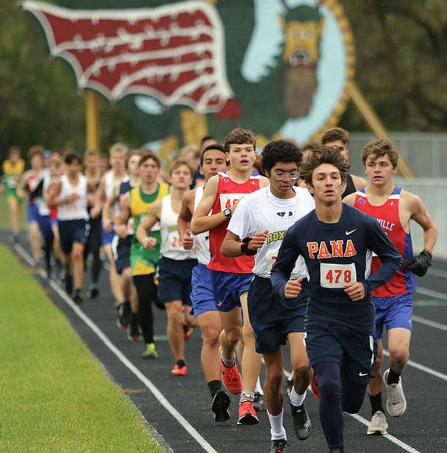 Pana's Brayden Cordero leads the field during the first of two laps on the track before the race turns cross country in the South Central Conference Meet at Southwestern High School in Piasa. Litchfield won the team title, while Roxana senior Carlos Ruvalcaba repeated as individual champion. Photo: Greg Shashack / The Telegraph