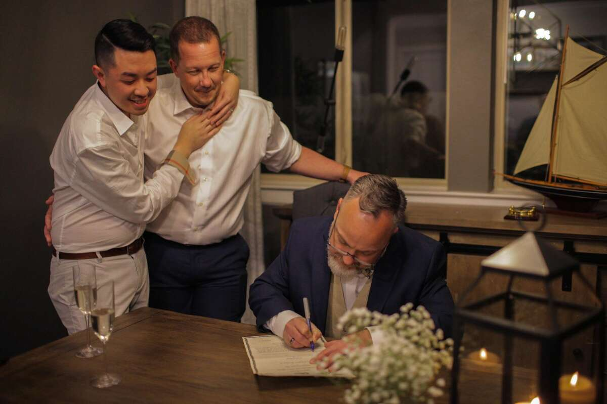 Dustin Ngo, left, and David McAlpin were married in February 2020.