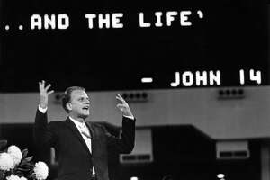 """11/22/1965 - Evangelist Billy Graham delivers sermon during his Greater Houston Crusade in the Astrodome. Behind him, the scoreboard was lit up with quote from John 14, """"I am the way ... the truth ... and the life."""""""