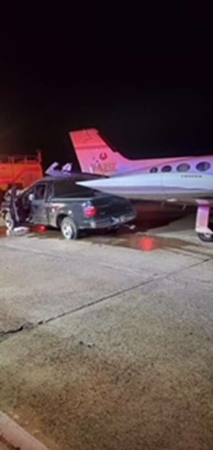 This Ford F-150 suspected of being involved in a hit-and-run incident crashed into an aircraft following a pursuit with Laredo police early Wednesday at the Laredo International Airport. Photo: Courtesy