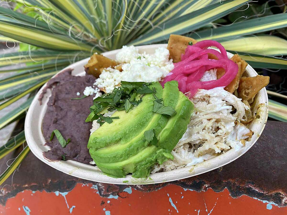 Mexican specialties at the new Chilaquil at the Bottling Department food hall at the Pearl in San Antonio include chilaquiles with salsa verde and chicken.