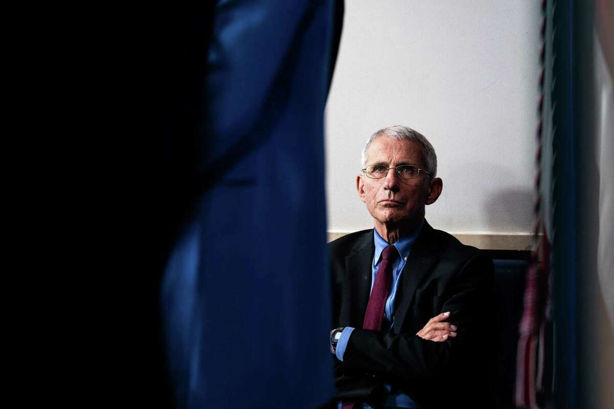 Dr. Anthony Fauci, director of the National Institute of Allergy and Infectious Diseases, listens to President Donald Trump speak about the coronavirus during a task force news conference at the White House in Washington, March 27, 2020.
