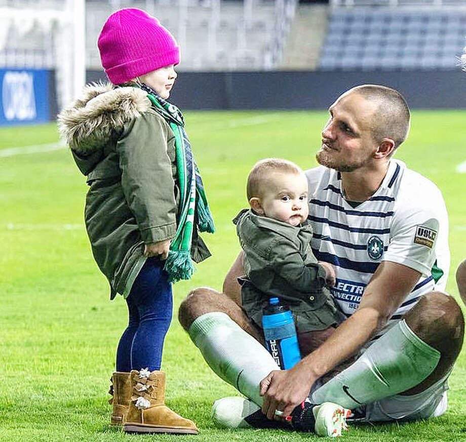 Sam Fink visits with daughters Evelyn, left, and Eleanor on the pitch Saturday night at Lynn Family Stadium in Louisville, Ky. Fink's STLFC soccer team lost its USL playoff game to Louisville City 2-0, ending a six-year run in St. Louis. The team is ceasing operations to make way for the Major League Soccer expansion St. Louis City SC team, which will begin playing in 2023. Photo: Submitted File