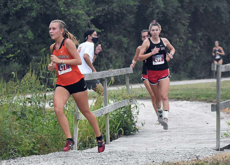 Edwardsville senior Kaitlyn Loyet crosses a bridge during the Belleville West Invitational on Sept. 12 in Belleville. Loyet took 11th place, helping the Tigers to a first-place finish.