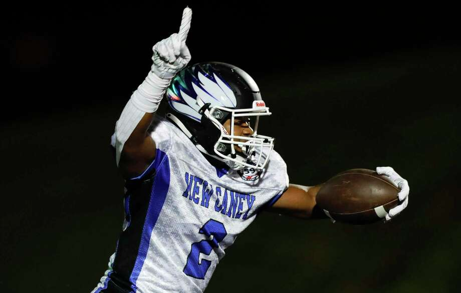 New Caney wide receiver Billy Williams, Jr. (2) reacts after catching a 39-yard touchdown pass from quarterback Jaydon Tutwiler-Drew during the first quarter of a District 8-5A high school football game at Randall Reed Stadium, Friday, Oct. 9, 2020, in Porter. Photo: Jason Fochtman, Houston Chronicle / Staff Photographer / 2020 © Houston Chronicle