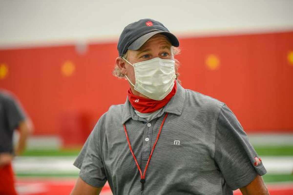 UH football coach Dana Holgorsen, at a recent workout with a mask donated by Ascend Performance Materials.