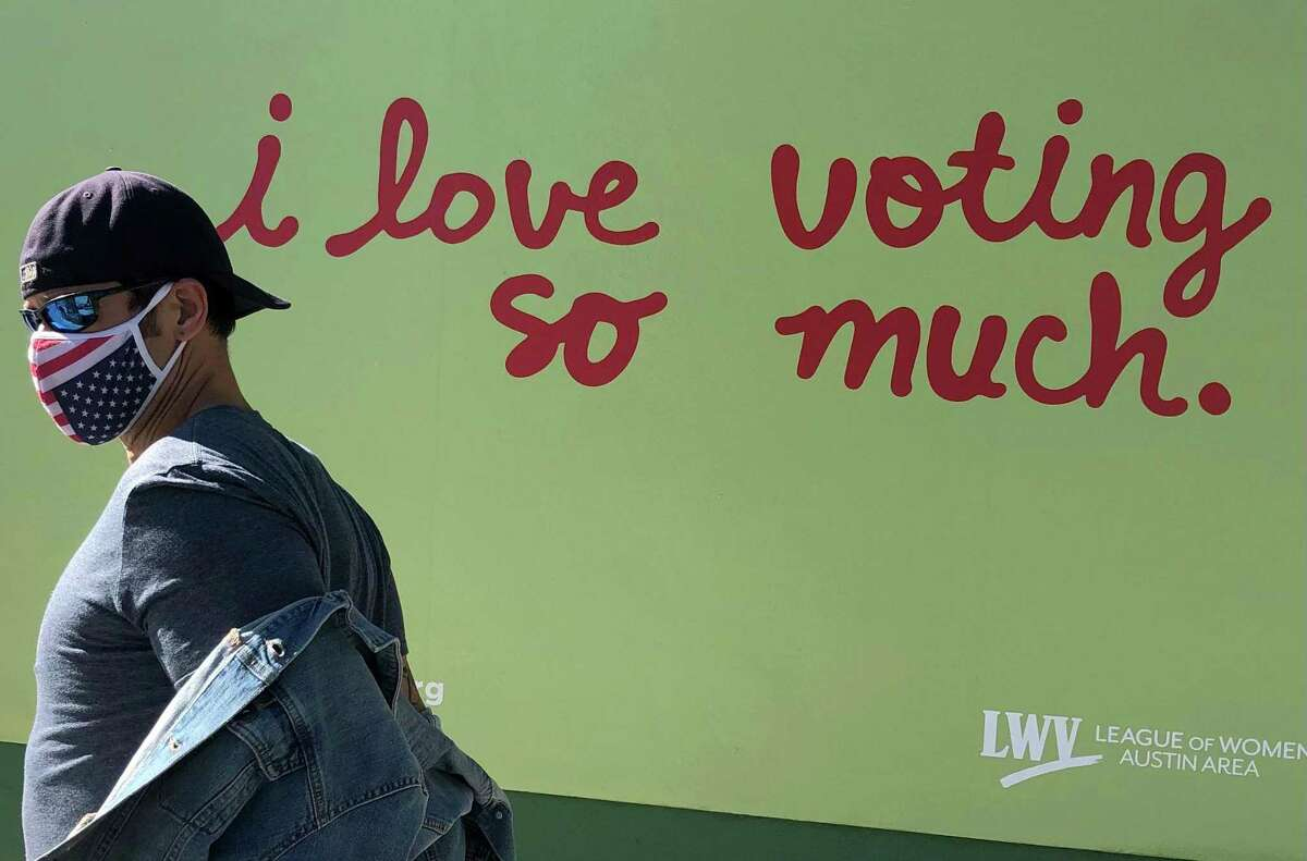 A popular mural outside Jo's Coffee in a trendy section of Austin, Texas, has been repainted for the election.