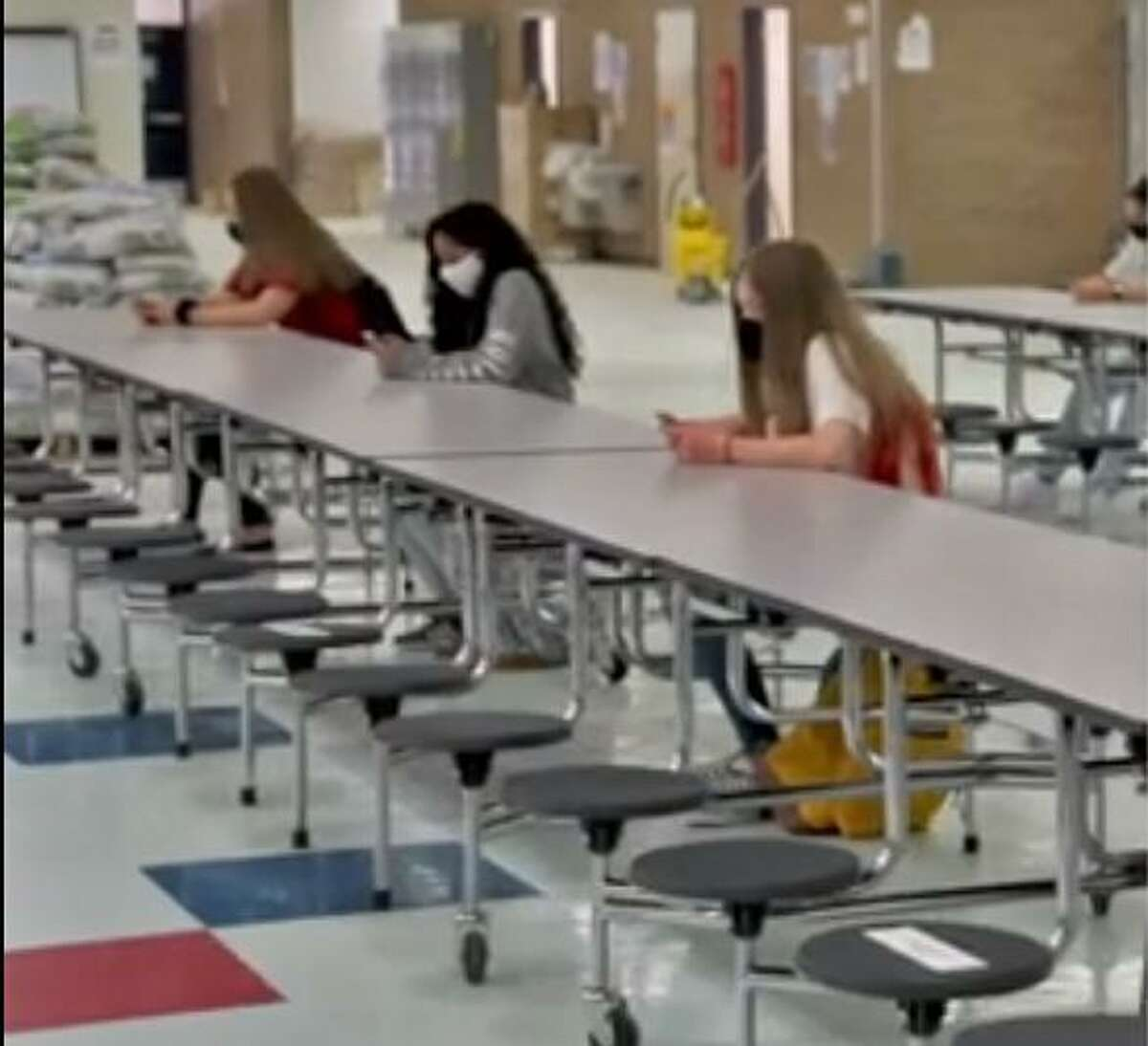High school student social distancing during lunch in a instructional video posted to the Fort Bend ISD website on Sept. 3.