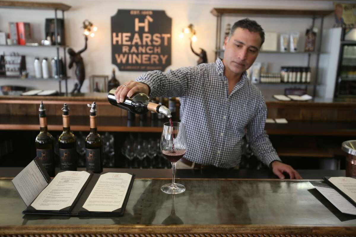 J.P. Garay pours a 2015 Malbec in the Hearst Ranch Winery tasting room on Wednesday, October 24, 2018 in San Simeon, California.