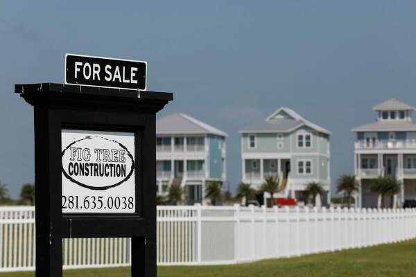 Lots are for sale as homes are under construction along east beach Saturday, Oct. 17, 2020, in Galveston.